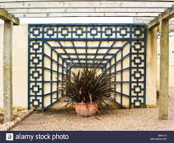 garden design using ornamental trellis against a wall stock photo