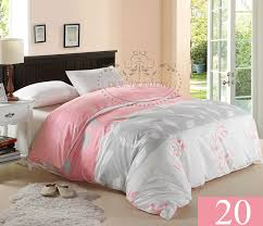 modern bedroom with pink silver king size bed duvet cover dark