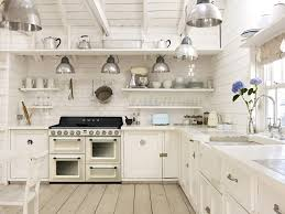 white country kitchen filled with smeg small appliances and range