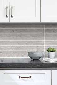 white kitchen cabinets with light grey backsplash ba1038 limestone
