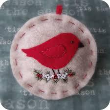 little red bird on oatmeal felt christmas ornament christmas