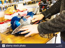 sharpening knife on grinder grinding on bench grinder using making