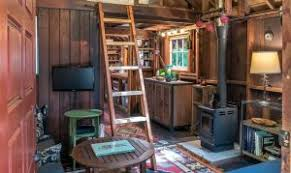 tiny house innovations this rustic tiny house has a treehouse too