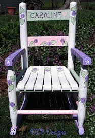 whimsically hand painted wood rocking chair makes a unique and