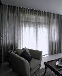 modern window treatments pool the long drapes at the floor for a