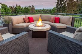 outdoor propane fire pit with white ceramic floor and brown