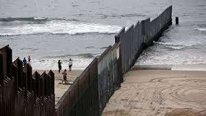 Flag Of Mexico Picture The Border Fence Meets The Sea A Strange Beach Scene Contrasting