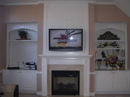 furniture white fireplace under wall mount tv among white stained