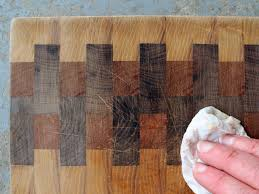 how to restore and maintain a wood cutting board or butcher block clean off sanding dust