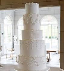 caramel drip cake with fresh flowers image something about cake