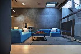 living room unique round coffee table and blue wall means soft