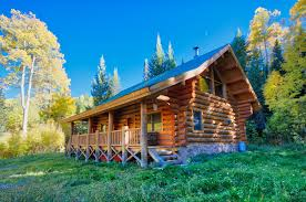 log cabin with acreage in the western colorado mountains log
