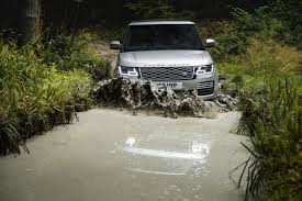 land rover mud the latest range rover is a plug in hybrid that can still handle