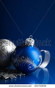 blue silver christmas ornaments on dark stock photo 164710958