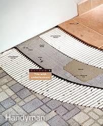 How To Level A Bathroom Floor How To Tile Bathroom Floors Family Handyman