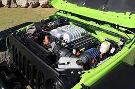 hellcat engine behind the wheel of the 707 hp jeep trailcat concept