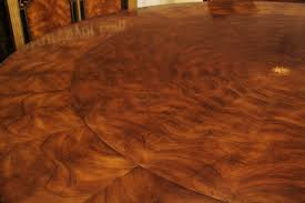 round dining table perimeter leaves large 64 88 inch expandable round mahogany dining table