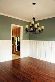 wainscoting in the dining room classic but pub rail height with