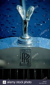 name logo and spirit of ecstasy sculpture on a rolls royce