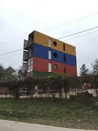 these storage container homes are being built down the street from