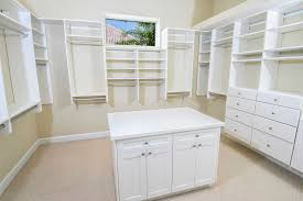 Garage Cabinet Set White Wooden Double Door Storage Cabinet On Gray Painted Wall Room