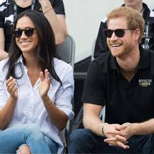 prince harry and meghan markle show affection at invictus games
