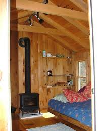 Wood Stove Rugs Adorable Small Cabin Wood Stove Using Wall Mounted Wooden Shelving