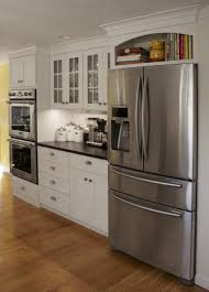 White Kitchen Cabinets With Granite Countertops White Wooden And Glass Kitchen Cabinet Brown Wooden Floor Black