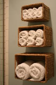Bathroom Storage Solutions by Wall Mounted Rattan Basket For Towel Bathroom Storage Ideas Hang