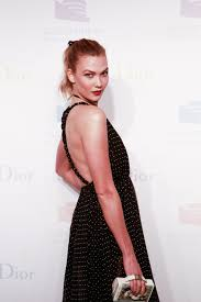 karlie kloss upgrades a swingy ponytail with a black ribbon vogue