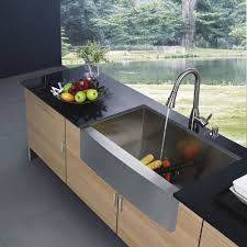 luxury contemporary kitchen cabinets with honed black top and