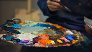 mixing paint colors with brush stock footage video 6234545