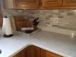 what color quartz with oak cabinets oak cabinets with lyra quartz and marble backsplash oak