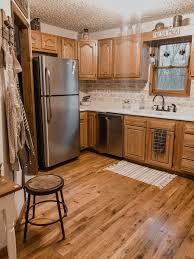farmhouse style kitchen with oak cabinets farmhouse kitchen vinyl flooring kitchen kitchen cabinets
