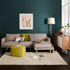 style house canapé déco salon mur bleu canard foncé canapé gris pouf et coussin