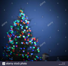 christmas tree shaped lights blurry christmas tree with bokeh heart shaped lights stock photo
