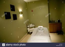 empty massage room in spa with mattress made for pregnant woman