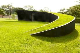 swirling green roofed coin house built in accordance with
