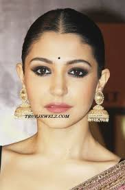big jhumka gold earrings big antique gold pearl jhumkas look great with traditional
