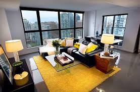how to decorate your home with color pairs black couches yellow