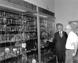 florida memory sightseers viewing collection of light bulbs at