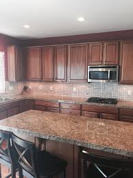 how to clean cherry wood cabinets should i paint my cherry wood cabinets white