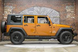 jeep wrangler orange 2010 jeep wrangler unlimited sport 2wd auto