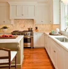 traditional kitchen backsplash we love this classic penny tile backsplash see more ideas http