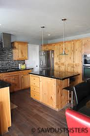 how to refinish alder wood cabinets from knotty alder to light grey kitchen cabinets sawdust