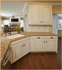 white kitchen cabinets with backsplash picture of antique white kitchen cabinets with granite countertops