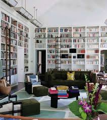 home library design with built in shelves and sofa and chair and