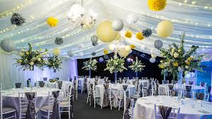 tissue pom poms and paper lanterns are a beautiful combination