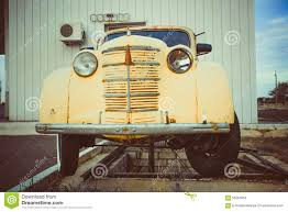 yellow volkswagen beetle royalty free yellow volkswagen beetle vintage car in a street stock photo