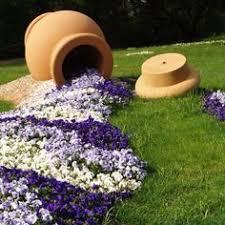 20 ideas para decorar el jardín con cosas recicladas flower